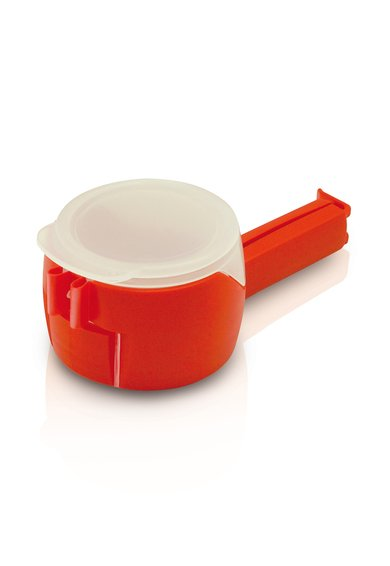 Dispozitiv de sigilare a pungilor prevazut cu capac